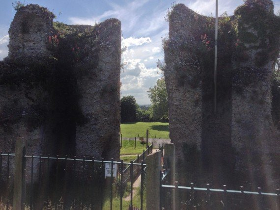 A view from inside of Bungay Castle showing the two gate towers and looking out over Earshot and the Waveney Valley.